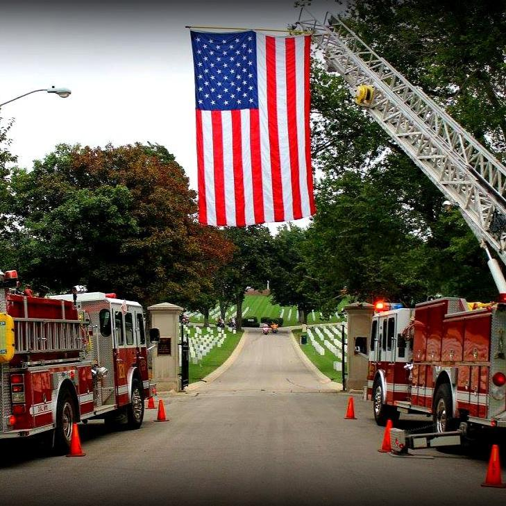 Fire Trucks and American Flag at Cemetery