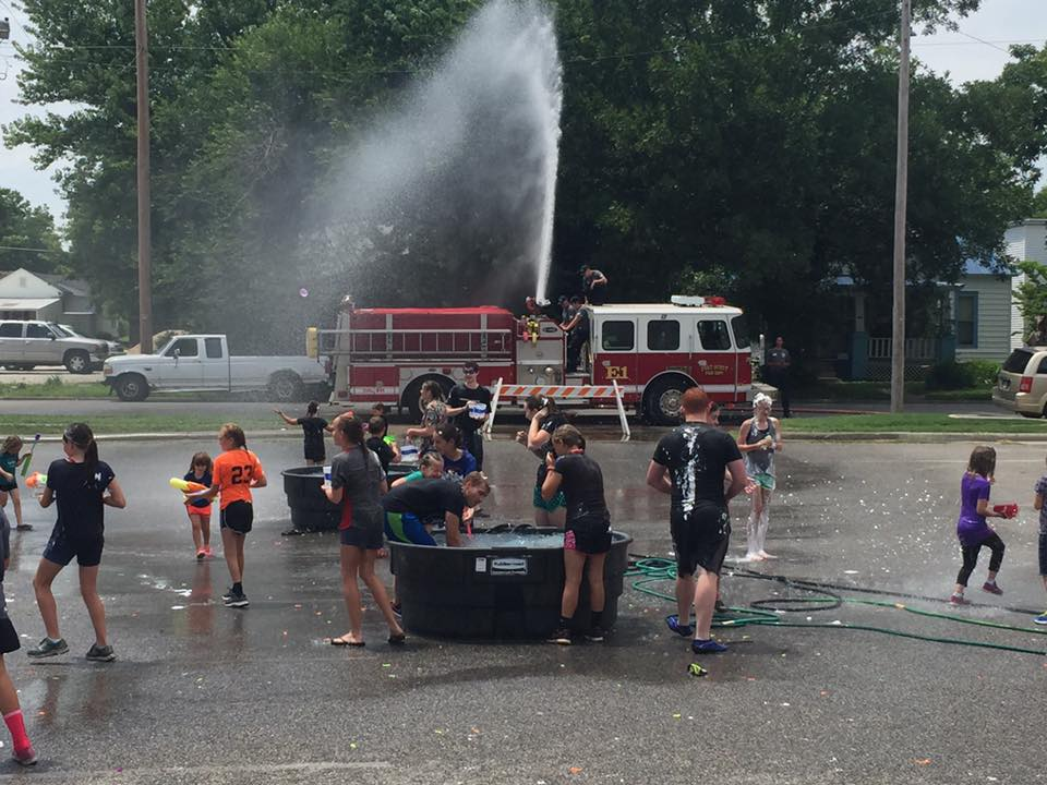 Kids Play in Fire Hose Water