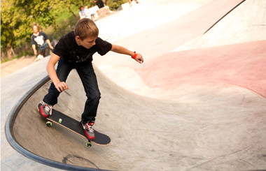 A boy riding a skateboard in a skate park