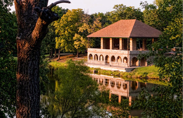 A park pavilion overlooking a stream